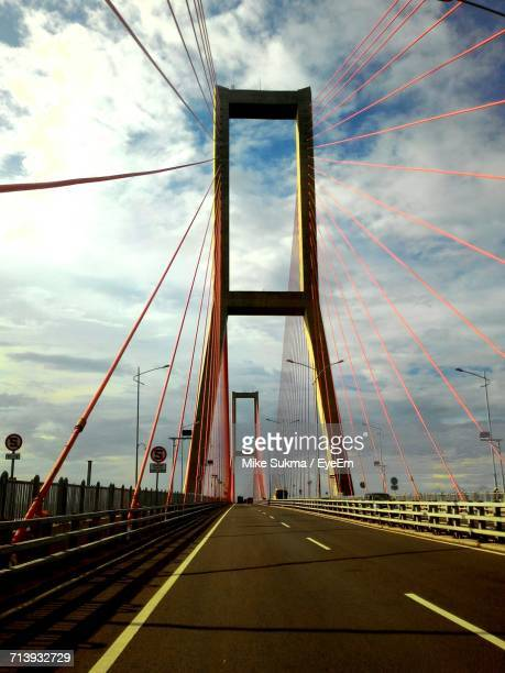 Suspension Bridge Against Cloudy Sky