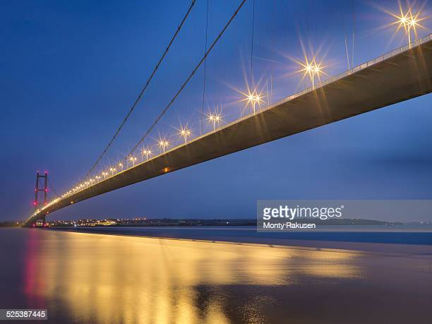 Suspension bridge at night. The Humber Bridge, UK was built in 1981 and at the time was the worlds largest single-span suspension bridge