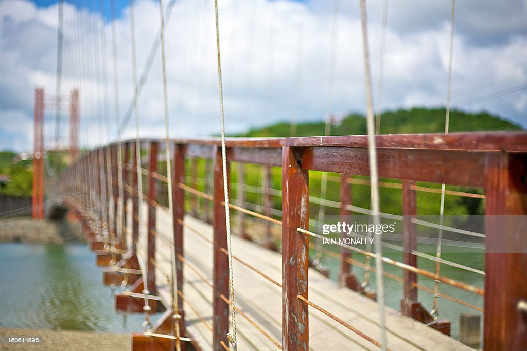 CONTENT] A suspension bridge is seen across a river.