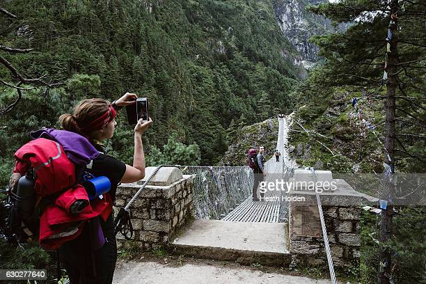 Suspension bridges stretch across large valleys and are are a very photogenic part of on the trail on September 20 2016 in Namche Bazar Nepal The...