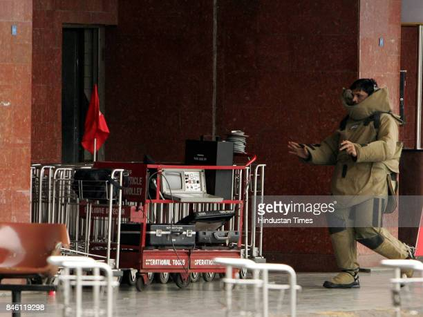 A suspicious black bag being checked for explosives by a specialist from the Bomb Detection Disposal Squad under the Bureau of Civil Aviation at the...