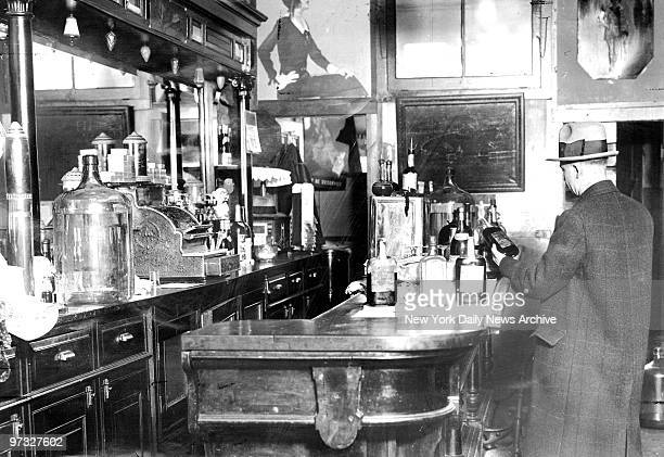 Suspicious federal officers who followed an auto loaded with two barrels were rewarded by discovery of this speakeasy at 615 West Market Street...