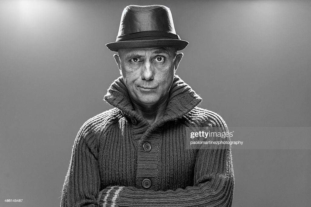 Suspicious man with sweater and hat