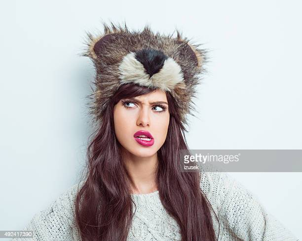 Suspicious woman wearing fur cap