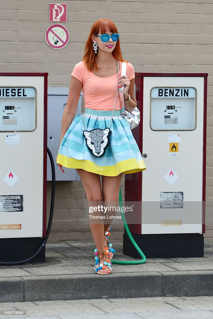 Sussan Zeck is wearing a jacket by Christian Pellizzari, a skirt bei HOPPER, a bag and bracelet by Marc Cain and shoes by Moda Espana during the Mercedes-Benz Fashion Week Berlin Spring/Summer 2017 at Erika Hess Eisstadion on June 29, 2016 in Berlin, Germany.