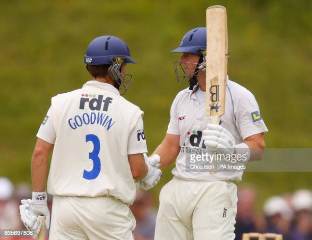 Sussex batsman Chris Nash celebrates his 50 runs with team mate Murray Goodwin during the Liverpool Victoria County Championship Division One match...