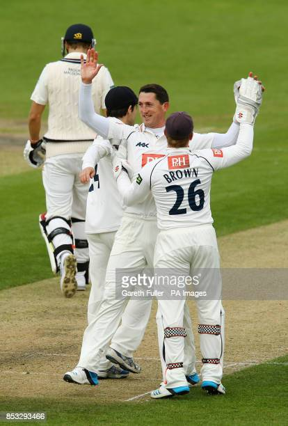 Sussex bowler Jon Lewis celebrates taking the wicket of David Malan his third wicket during the LV=County Championship Division One match at the...