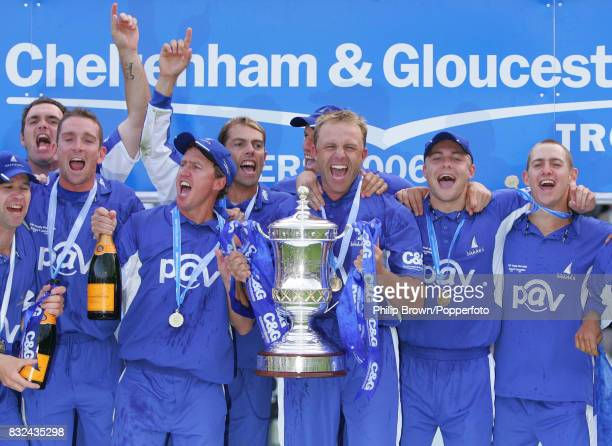 Sussex captain Chris Adams holds the trophy after Sussex win the Cheltenham and Gloucester Trophy Final between Lancashire and Sussex by 15 runs at...