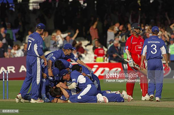 Sussex players pile on top of bowler James Kirtley after he dismissed Murali Kartik of Lancashire lbw to give Sussex the win in the Cheltenham...