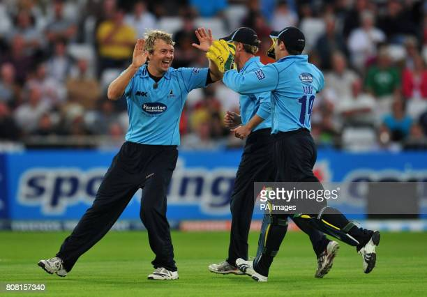 Sussex Sharks' Chris Nash celebrates with his team mates after taking the wicket of Nottinghamshire Outlaws' David Hussey during the Friends...