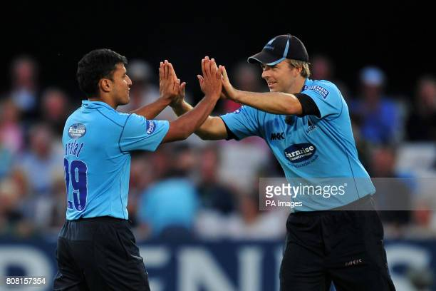 Sussex Sharks' Yasar Arafat celebrates with his team mate Chris Nash after taking the wicket of Nottinghamshire Outlaws' Graeme White during the...
