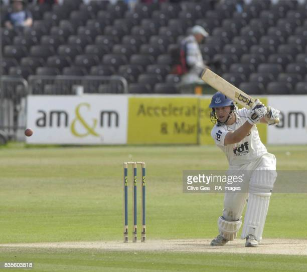 Sussex's Chris Nash hits the ball for four on his way to a century during the Liverpool Victoria County Championship match at the County Ground Hove