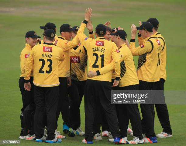 Sussex's players celebrate the wicket of Middlesex's Brendon McCullum