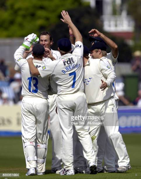 Sussex's Robin MartinJenkins is congratulated by his Sussex team mates after taking the wicket of Lancashire's Francois Du Plessis during the...