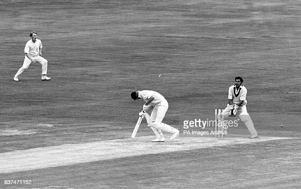 Sussex's Tony Greig is bowled by David Hughes of Lancashire Also pictured is Lancashire wicketkeeper Farokh Engineer