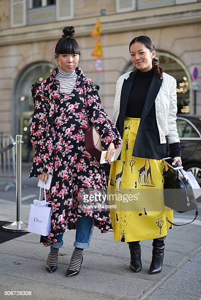 Susy Lau and Tina Leung pose before the Miu Miu presentation at Place Beauvau during Haute Couture on January 25 2016 in Paris France
