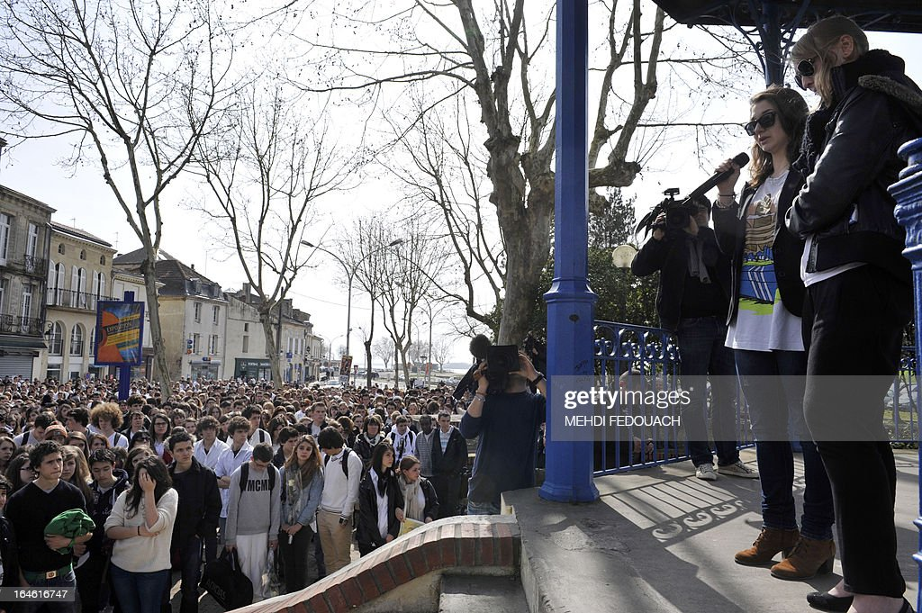 Susy (2nd R) speaks on March 25, 2013 during a ceremony and march in honour of Sylvain, her boyfriend, 15-year-old schoolboy stabbed on March 19 by a 19-year-old comrade in a classroom of the Estuaire college in Blaye, southwestern France.