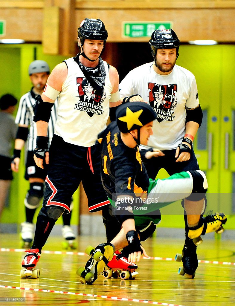 Sutton Impact and Samdroid of Southern Discomfort and Dark Matter of Tyne and Fear bout in the Men's European Cup roller derby tournament at Walker Activity Dome on August 31, 2014 in Newcastle upon Tyne, England.