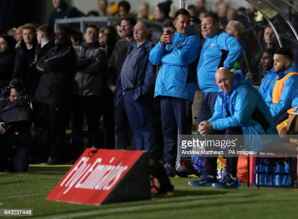Sutton substitute goal keeper Wayne Shaw and manager Paul Doswell during the Emirates FA Cup Fifth Round match at Gander Green Lane London