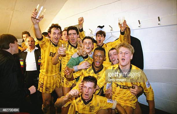 Sutton United players including goalscorers Tony Rains and Matthew Hanlan celebrate in the dressing room after the FA Cup 3rd Round match between...