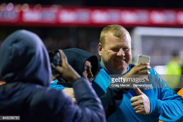 Sutton United reserve goalkeeper Wayne Shaw poses for a selfie with fans after the Emirates FA Cup Fifth Round match between Sutton United and...