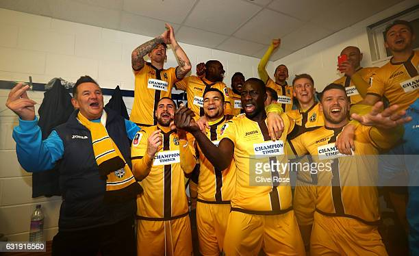 Sutton United team celebrate after the final whistle in the changing room after the Emirates FA Cup third round replay between AFC Wimbledon and...