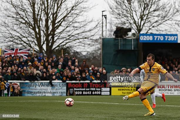 Sutton United's English defender Jamie Collins scores the opening goal from the penalty spot during the English FA Cup fourth round football match...