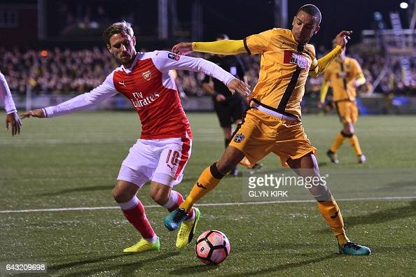 Sutton United's English midfielder Craig Eastmond vies with Arsenal's Spanish defender Nacho Monreal during the English FA Cup fifth round football...
