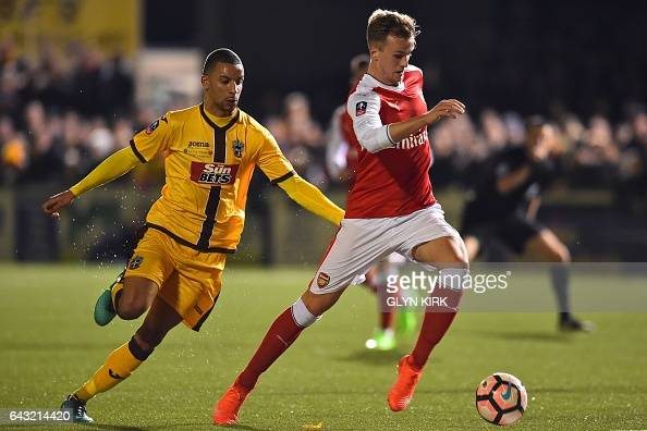 Sutton United's English midfielder Craig Eastmond vies with Arsenal's English defender Rob Holding during the English FA Cup fifth round football...