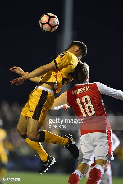 Sutton United's French striker Maxime Biamou vies with Arsenal's Spanish defender Nacho Monreal during the English FA Cup fifth round football match...