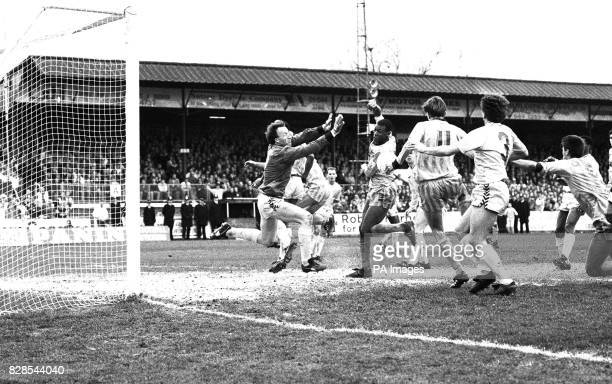 Sutton United's Matthew Hanlan kicks past Coventry City's keeper Steve Ogrizovic to score the second goal in the shock match where nonleague Sutton...