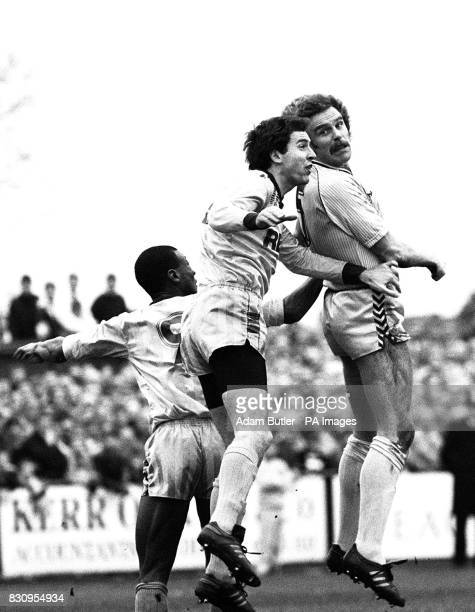 Sutton United's Nigel Golley and Coventry City's Brian Kilcline in a headtohead during their FA Cup third round match at Sutton