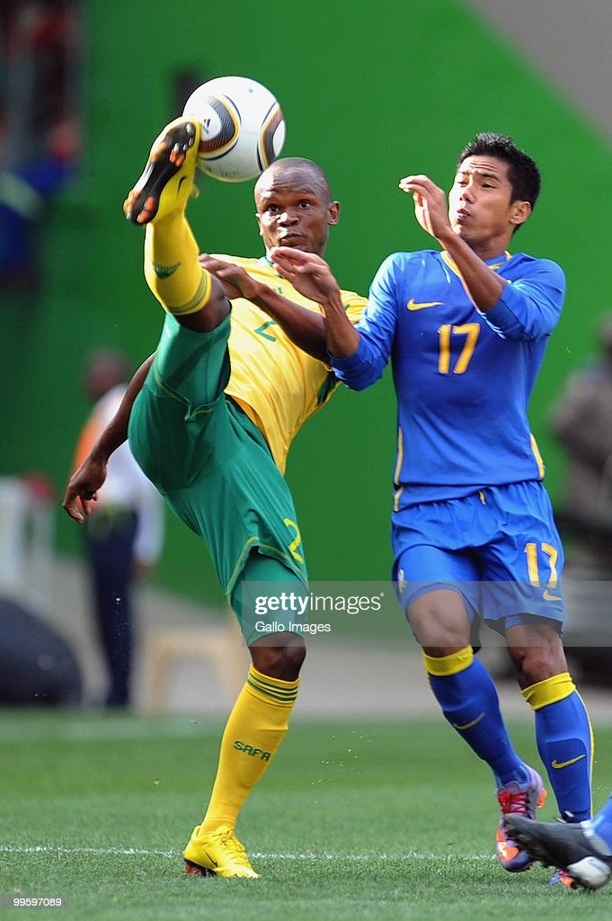 Sutu Sonsonkit of Thailand and Siboniso Gaxa of South Africa compete during the International Friendly match between South Africa and Thailand from...