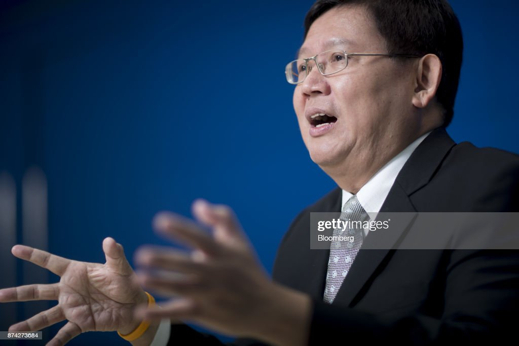 Suvit Maesincee, Thailand's vice minister of the prime minister and an adviser to the minister of finance, gestures while speaking during an interview in Bangkok, Thailand, on Friday, Nov. 10, 2017. Suvit said Thailand remains on course for elections next year and that curbs on political parties will soon be eased, as pressure mounts on the military government to roll back restrictions on campaigning. Photographer: Brent Lewin/Bloomberg via Getty Images