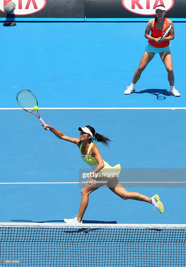 Su-Wei Hsieh of Chinese Taipei and Shuai Peng of China in action in their third round doubles match against Sara Errani and Roberta Vinci of Italy during day seven of the 2013 Australian Open at Melbourne Park on January 20, 2013 in Melbourne, Australia.