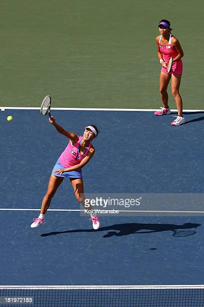 Suwei Hsieh of Chinese Taipei and Shuai Peng of China in action during their match against Cara Black of Zimbabwe and Sania Mirza of India in the...