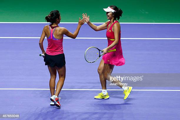 SuWei Hsieh of Taipei and Shuai Peng of China celebrate defeating Garbine Muguruza and Carla Suarez Navarro of Spain in the doubles quarter finals...