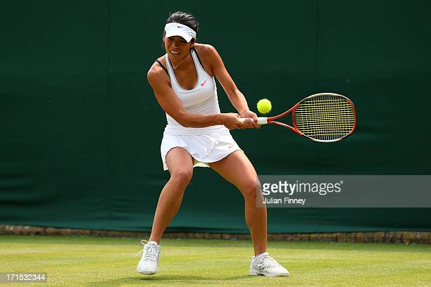 SuWei Hsieh of Taipei plays a backhand during her Ladies' Singles second round match against Alize Cornet of France on day three of the Wimbledon...