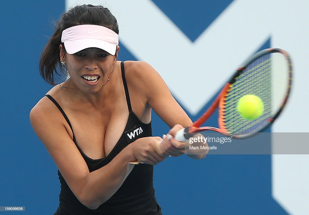 Su-Wei Hsieh of Taipei plays a backhand in her first round match against Shuai Peng of China during day four of the Hobart International at Domain Tennis Centre on January 7, 2013 in Hobart, Australia.