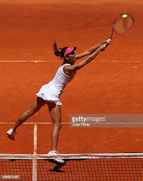 SuWei Hsieh of Taipei plays a volley with Shuai Peng of China in their match against Garbine Muguruza and Carla Suarez Navarro of Spain in the...