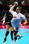 Suzana Lazovic of Montenegro shoots ahead of Begona Fernandez Molinos of Spain during the Women's Handball semifinal game between Spain and...