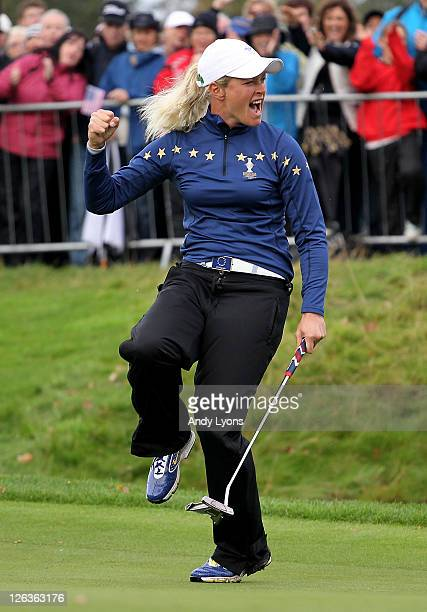 Suzann Pettersen of Europe celebrates on the 18th green during the singles matches on day three of the 2011 Solheim Cup at Killeen Castle Golf Club...