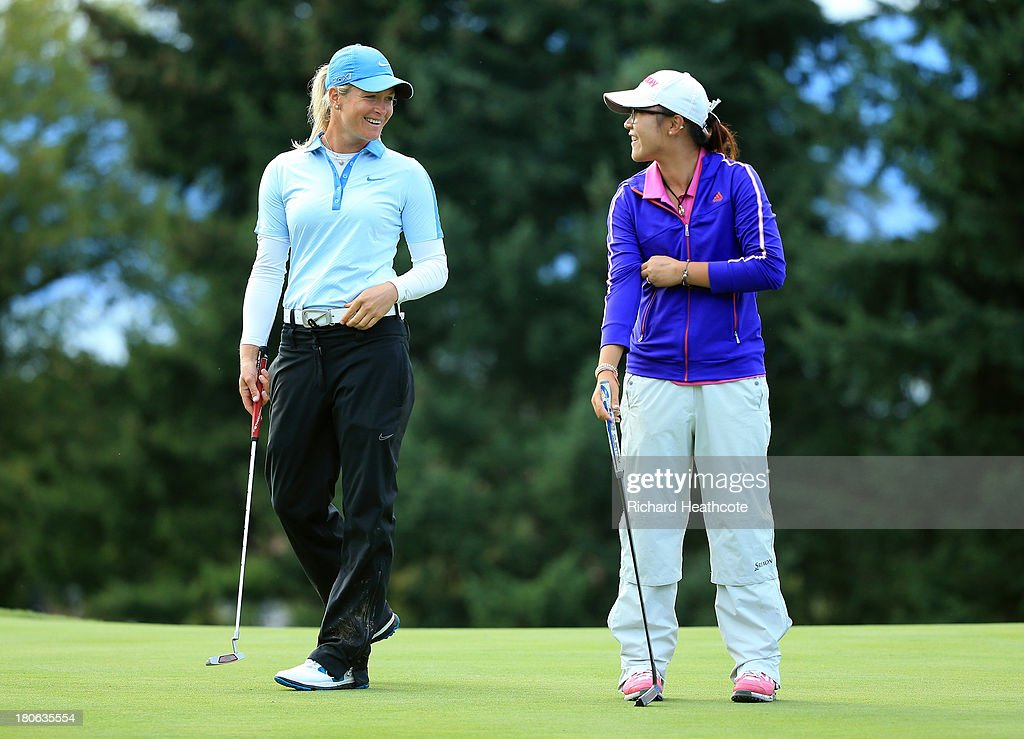 <a gi-track='captionPersonalityLinkClicked' href=/galleries/search?phrase=Suzann+Pettersen&family=editorial&specificpeople=218091 ng-click='$event.stopPropagation()'>Suzann Pettersen</a> of Norway and Amateur <a gi-track='captionPersonalityLinkClicked' href=/galleries/search?phrase=Lydia+Ko&family=editorial&specificpeople=5817103 ng-click='$event.stopPropagation()'>Lydia Ko</a> of New Zealand during the third round of The Evian Championship at the Evian Resort Golf Club on September 15, 2013 in Evian-les-Bains, France.