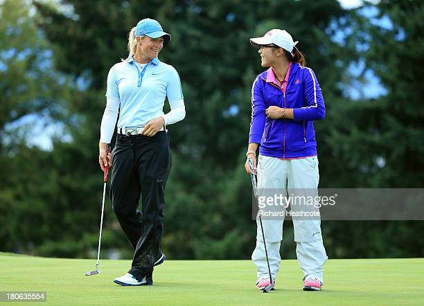 Suzann Pettersen of Norway and Amateur Lydia Ko of New Zealand during the third round of The Evian Championship at the Evian Resort Golf Club on...
