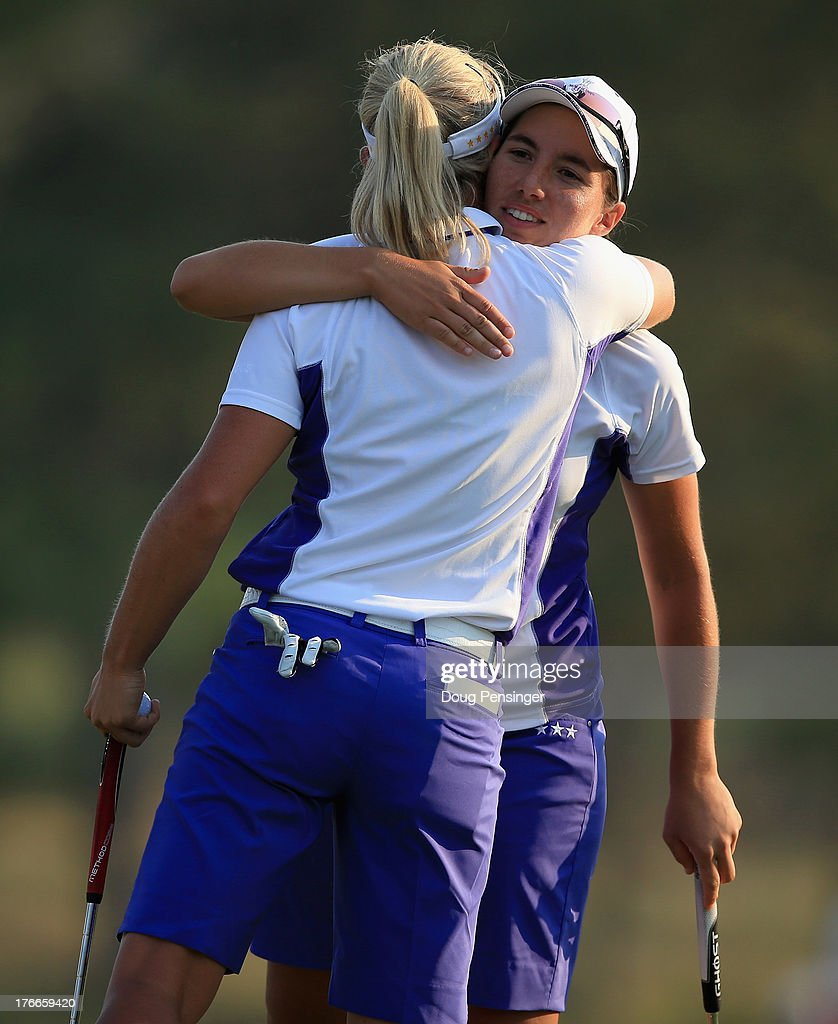 <a gi-track='captionPersonalityLinkClicked' href=/galleries/search?phrase=Suzann+Pettersen&family=editorial&specificpeople=218091 ng-click='$event.stopPropagation()'>Suzann Pettersen</a> of Norway and <a gi-track='captionPersonalityLinkClicked' href=/galleries/search?phrase=Carlota+Ciganda&family=editorial&specificpeople=2259692 ng-click='$event.stopPropagation()'>Carlota Ciganda</a> of Spain and the European Team celebrate on the 18th green after defeating Stacy Lewis and Lexi Thompson of the United States Team by one hole during the afternoon four-ball matches at the 2013 Solheim Cup on August 16, 2013 at the Colorado Golf Club in Parker, Colorado.