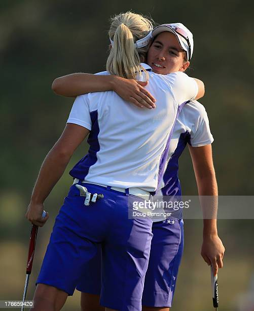Suzann Pettersen of Norway and Carlota Ciganda of Spain and the European Team celebrate on the 18th green after defeating Stacy Lewis and Lexi...
