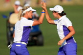 Suzann Pettersen of Norway and Carlota Ciganda of Spain and the European Team celebrate on the 16th green as they went on to defeat Stacy Lewis and...