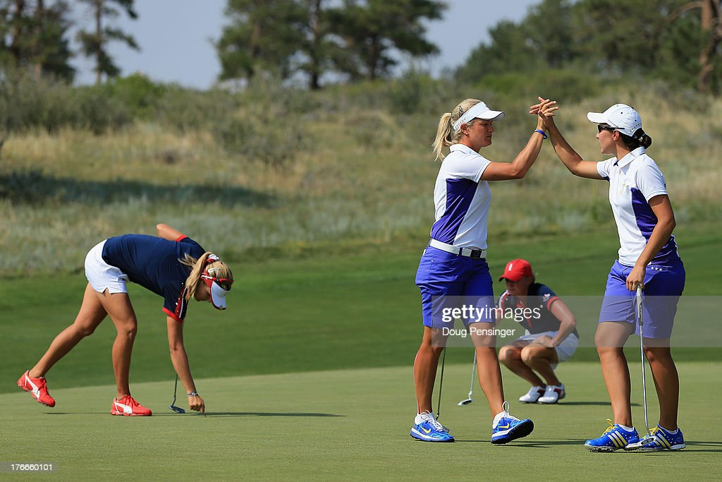 <a gi-track='captionPersonalityLinkClicked' href=/galleries/search?phrase=Suzann+Pettersen&family=editorial&specificpeople=218091 ng-click='$event.stopPropagation()'>Suzann Pettersen</a> (L) of Norway and <a gi-track='captionPersonalityLinkClicked' href=/galleries/search?phrase=Carlota+Ciganda&family=editorial&specificpeople=2259692 ng-click='$event.stopPropagation()'>Carlota Ciganda</a> (R) of Spain and the European Team celebrate on the 10th green as they went on to defeat <a gi-track='captionPersonalityLinkClicked' href=/galleries/search?phrase=Stacy+Lewis+-+Golfer&family=editorial&specificpeople=4217318 ng-click='$event.stopPropagation()'>Stacy Lewis</a> and Lexi Thompson of the United States Team by one hole during the afternoon four-ball matches at the 2013 Solheim Cup on August 16, 2013 at the Colorado Golf Club in Parker, Colorado.