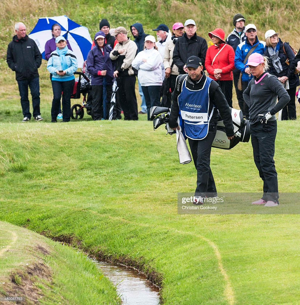 Suzann Pettersen of Norway and her caddy look in the water at the 18th green after her second shot ended in the water during the final round of the Aberdeen Asset Management Scottish Ladies Open at Dundonald Links Golf Course on July 26, 2015 in Troon, Scotland.