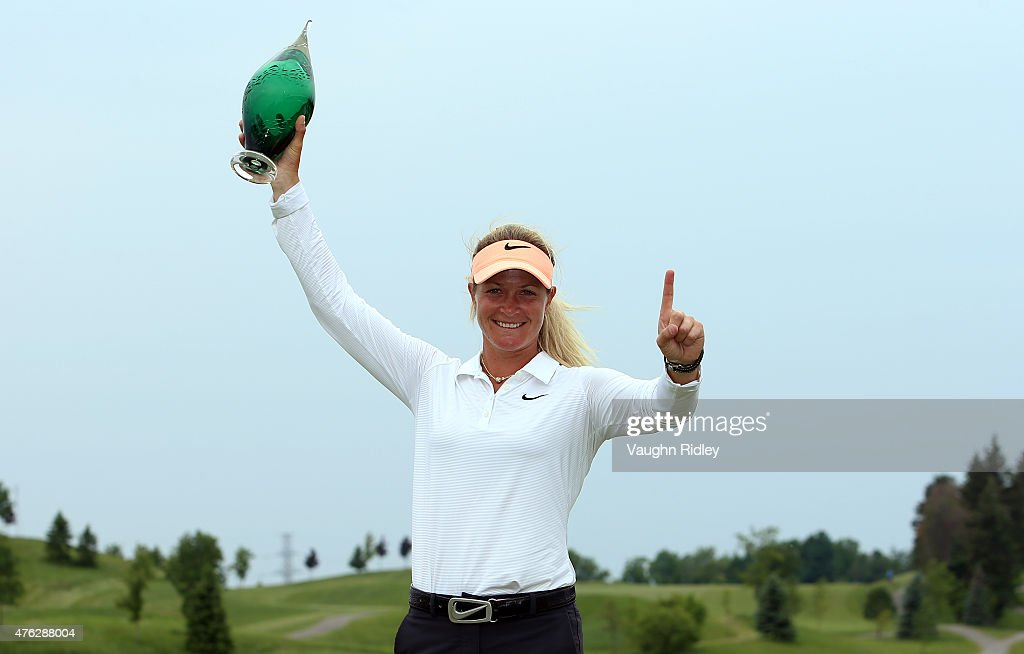 <a gi-track='captionPersonalityLinkClicked' href=/galleries/search?phrase=Suzann+Pettersen&family=editorial&specificpeople=218091 ng-click='$event.stopPropagation()'>Suzann Pettersen</a> of Norway celebrates with the champions trophy after winning the Manulife LPGA Classic at the Whistle Bear Golf Club on June 7, 2015 in Cambridge, Ontario, Canada.